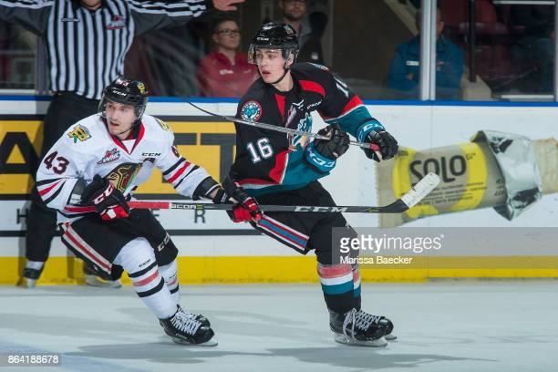 Skyler McKenzie of the Portland Winterhawks stick checks Kole Lind of the Kelowna Rockets during third period at Prospera Place on October 20 2017 in...