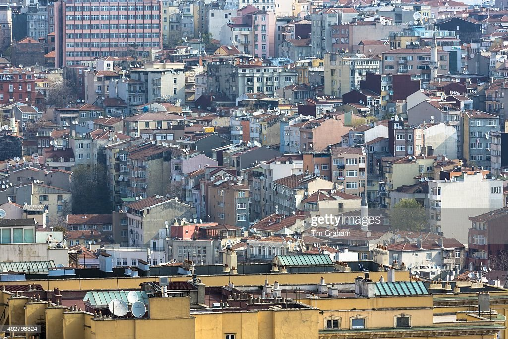 Skyline cityscape apartment blocks and offices of Karakoy and Beyoglu satellite dishes infrastructure in Istanbul Turkey
