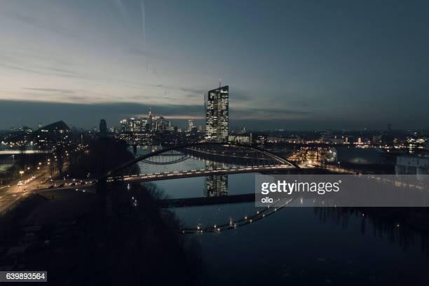 Skyline Frankfurt downtwon district at dusk - aerial view