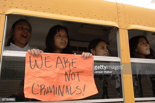 Skyline High School students display a sign from the window of a bus transporting them back to school after protesting in front of Dallas City Hall...