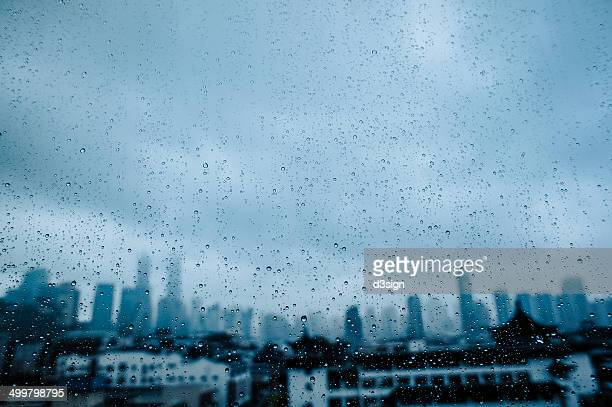 Skyline is seen through raindrop covered glass