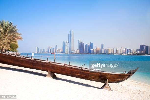 UAE, skyline of Abu Dhabi at the waterfront, beach