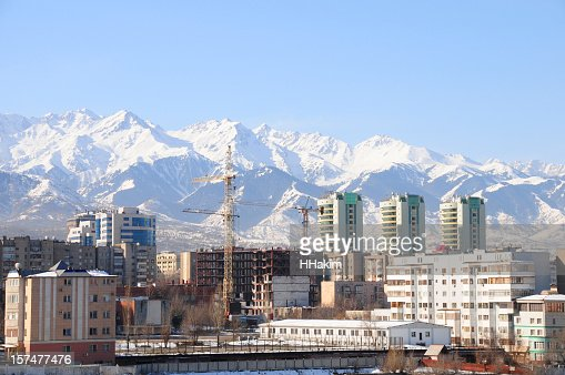 Skyline of Almaty city and snowy mountains