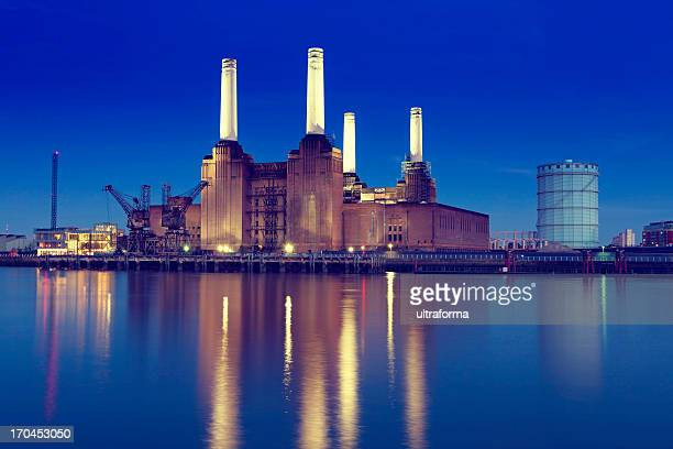 Skyline of Battersea Power Station with lake reflection