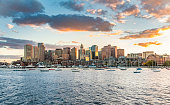 skyline of Boston, USA in sunset with harbor and skyscraper