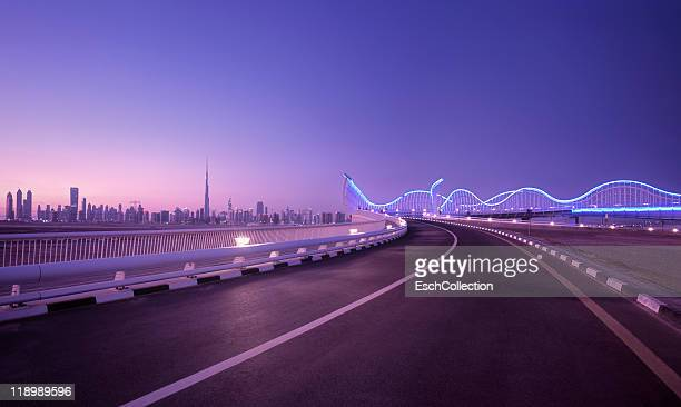 Skyline of Dubai with futuristic bridge, UAE