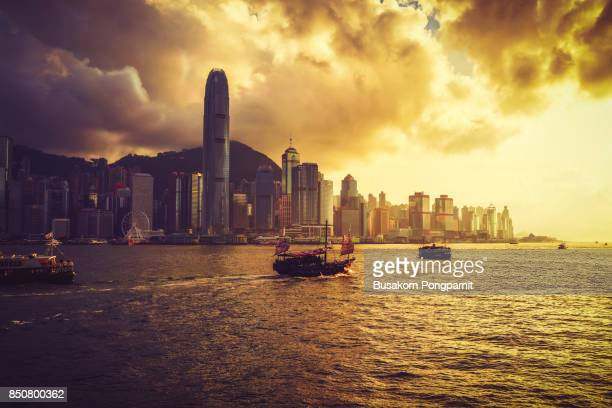 Skyline of Hong Kong  harbour with sunset.