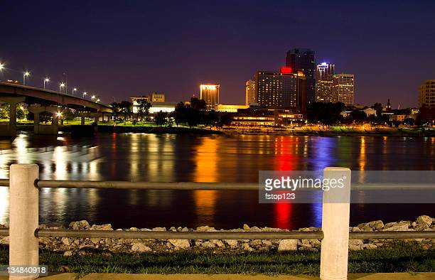 Skyline of Little Rock, Arkansas. Skyscrapers at night. River reflection.