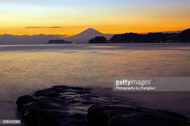 Skyline of Mount fuji over sea at Shonan at dark