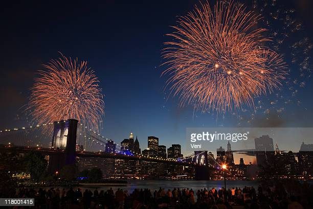 Skyline of New York at night with fireworks