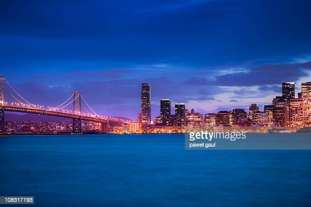 Skyline of San Francisco with Bay bridge at night