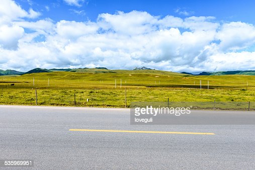 skyline,road and grass  field : Stock Photo