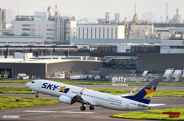 A Skymark Airlines Inc aircraft takes off at Haneda Airport in Tokyo Japan on Tuesday Aug 4 2015 Skymark's creditors will vote Wednesday on competing...