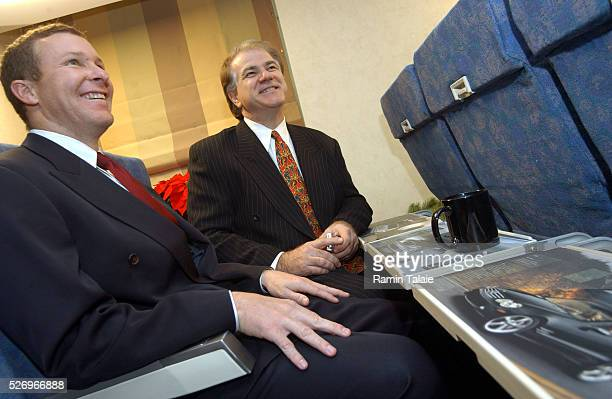 SkyMedia International President Nick Pajic and J Scott Kirby executive vice president of America West Airlines pose with tray tables during a news...