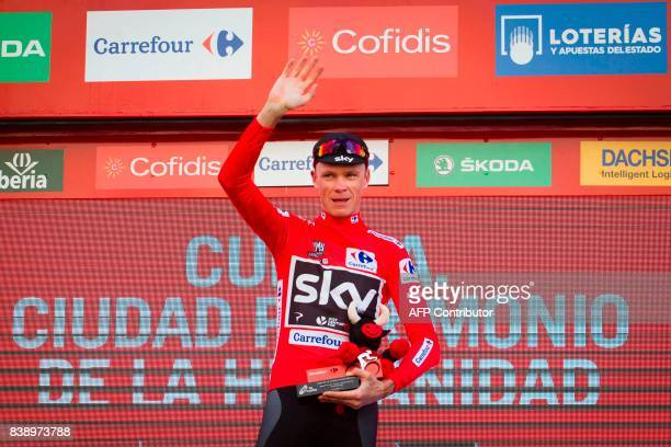 Sky's British cyclist Chris Froome celebrates his Red Jersey on the podium of the 7th stage of the 72nd edition of 'La Vuelta' Tour of Spain cycling...