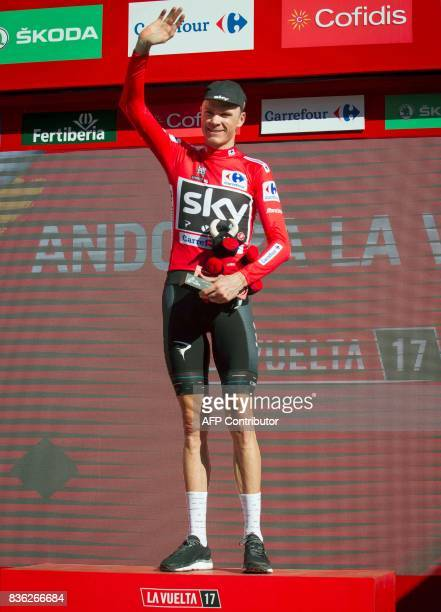 Sky's British cyclist Chris Froome celebrates on the podium with the leader's red jersey at the end of the 3rd stage of the 72nd edition of 'La...