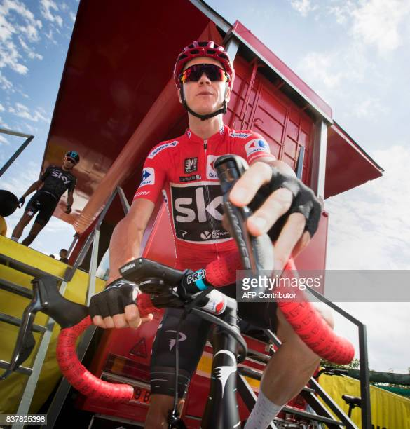 Sky's British cyclist Chris Froome looks on prior to the start of the 5th stage of the 72nd edition of 'La Vuelta' Tour of Spain cycling race a...