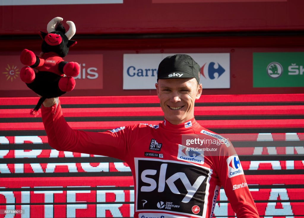 Sky's British cyclist Chris Froome poses on the podium with the leader's red jersey after the 4th stage of the 72nd edition of 'La Vuelta' Tour of Spain cycling race, a 198,2km route between Escaldes-Engordany to Tarragona on August 22, 2017. /