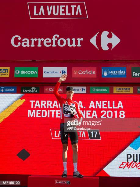 Sky's British cyclist Chris Froome poses on the podium with the leader's red jersey after the 4th stage of the 72nd edition of 'La Vuelta' Tour of...