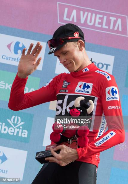 Sky's British cyclist Chris Froome poses on the podium with the leader's red jersey after the 5th stage of the 72nd edition of 'La Vuelta' Tour of...