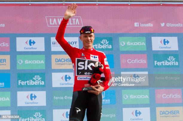 TOPSHOT Sky's British cyclist Chris Froome poses on the podium with the leader's red jersey after the 5th stage of the 72nd edition of 'La Vuelta'...