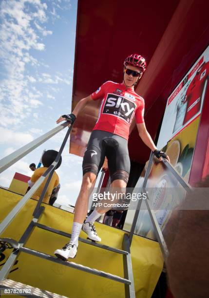Sky's British cyclist Chris Froome walks down the stairs after signing before the start of the 5th stage of the 72nd edition of 'La Vuelta' Tour of...
