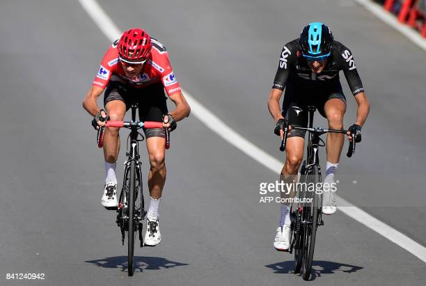 Sky's British cyclist Christopher Froome and Sky's Dutch cyclist Wout Poels cross the finish line of the 12th stage of the 72nd edition of 'La...