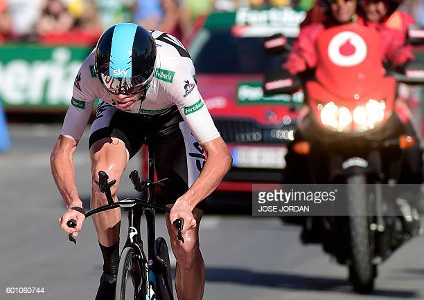 Sky's British cyclist Christopher Froome approaches the finish line to win the 19th stage of the 71st edition of 'La Vuelta' Tour of Spain a 39km...