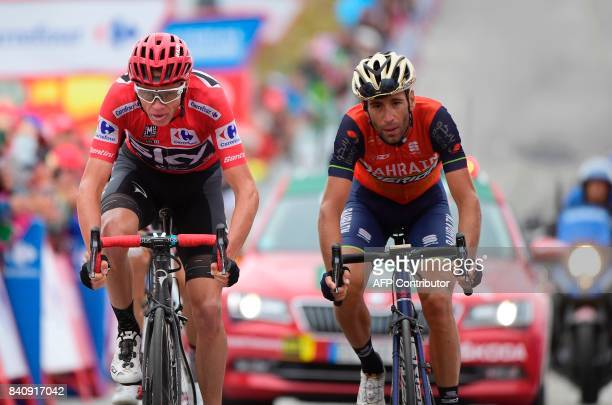 Sky's British cyclist Christopher Froome BahrainMerida's Italian Cyclist Vicenzo Nibali cross the finish line of the 11th stage during the 72nd...