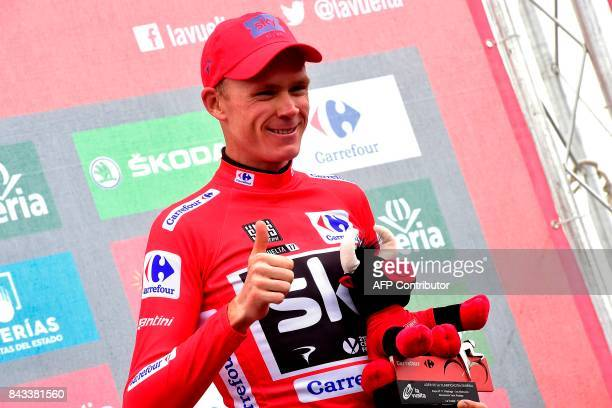 Sky's British cyclist Christopher Froome celebrates retaining the red jersey on the podium of the 17th stage of the 72nd edition of 'La Vuelta' Tour...