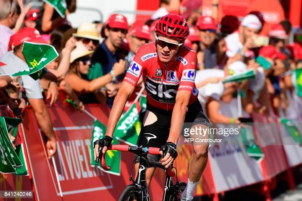 Sky's British cyclist Christopher Froome crosses the finish line of the 12th stage of the 72nd edition of 'La Vuelta' Tour of Spain cycling race a...
