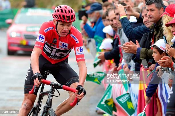Sky's British cyclist Christopher Froome crosses the finish line of the 17th stage of the 72nd edition of 'La Vuelta' Tour of Spain cycling race a...