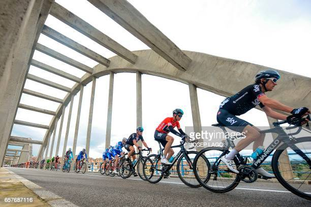 Sky's British rider Christopher Froome and his teammates lead the second pack as they cross a bridge over the Ebro river on the sixth day of the 97th...