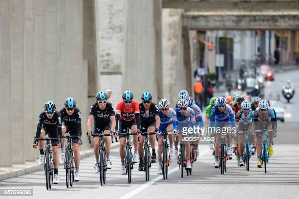 Sky's team and Sky's British rider Christopher Froome leads the second pack as cross the Ebro river of the sixth stage of the 97th Volta Catalunya...