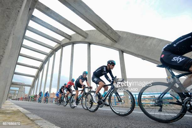Sky's team leads followed by the second pack as they cross a bridge over the Ebro river on the sixth day of the 97th Volta Catalunya 2017 a 1897km...