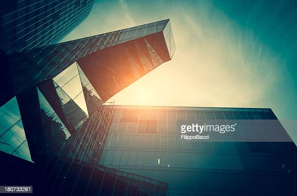 Skyscraper building with sunlight reflecting