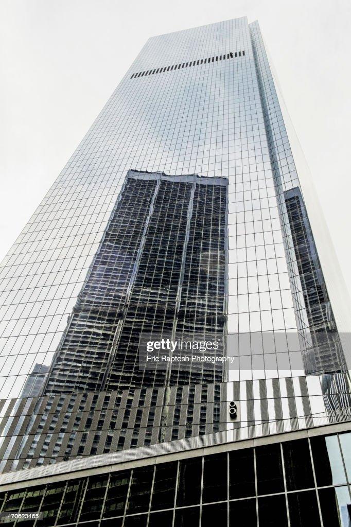 Skyscraper reflected in building windows, New York, New York, United States : Stock Photo