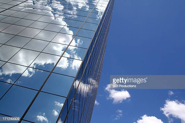 Skyscraper reflecting clouds in the sky