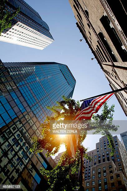 Skyscrapers and American flag, New York, New York State, USA