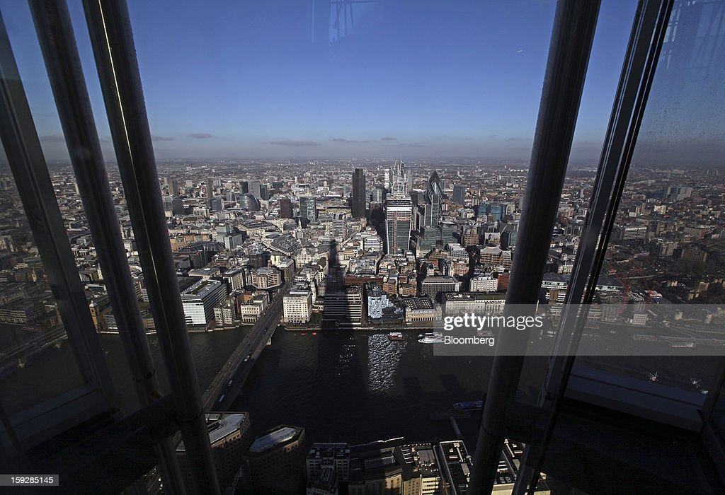 Skyscrapers and office buildings are seen in the City of London from 'The View From The Shard', a series of viewing galleries near the top of the Shard tower in London, U.K., on Wednesday, Jan. 9, 2013. The Shard, which stands at 309.6 meters on London's South Bank, is owned by LBQ Ltd., which brings together the State of Qatar (the majority shareholder) and Sellar Property Group Ltd., with non-equity funding by Qatar National Bank. Photographer: Chris Ratcliffe/Bloomberg via Getty Images