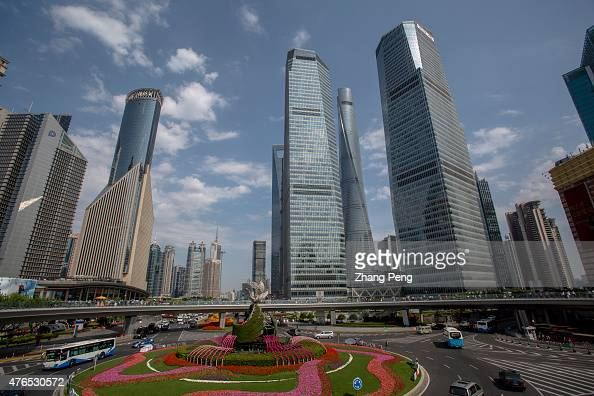 Skyscrapers and ring road in Lujiazui Located in the Pudong New District on the eastern bank of Huangpu River Lujiazui is the financial center of...