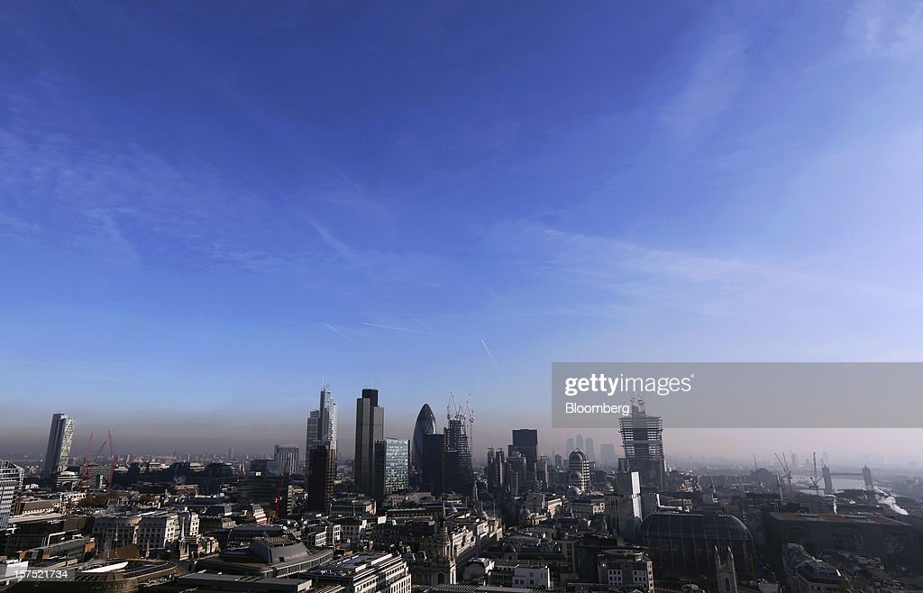 Skyscrapers and the construction sites of new commercial real estate developments stand on the skyline of the financial district in London, U.K., on Friday, Nov. 30, 2012. U.K. banks have become more unwilling to finance development projects without a tenant committed to lease space or a buyer for the completed property. Photographer: Chris Ratcliffe/Bloomberg via Getty Images