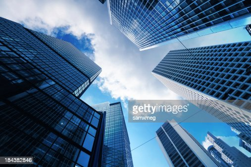 Skyscrapers from ground view with blue sky visible
