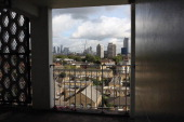 Skyscrapers in the City of London stand prominently on the horizon as viewed from a residential tower block in Vauxhall on October 17 2013 in London...