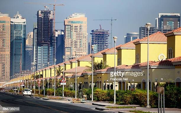 Skyscrapers is seen behind residential villas in Jumeirah Park on September 15 2015 in Dubai United Arab Emirates