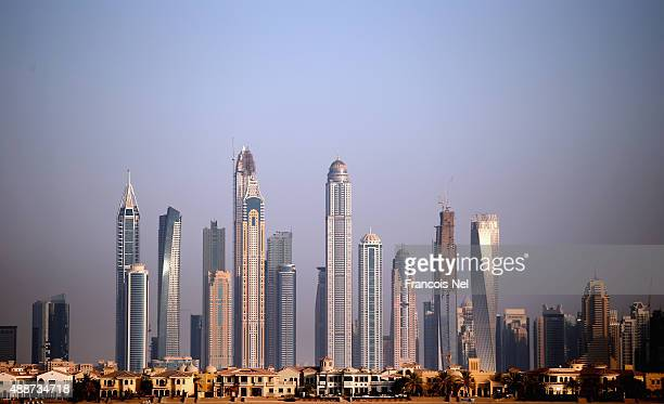 Skyscrapers is seen behind residential villas on Palm Jumeirah on September 14 2015 in Dubai United Arab Emirates