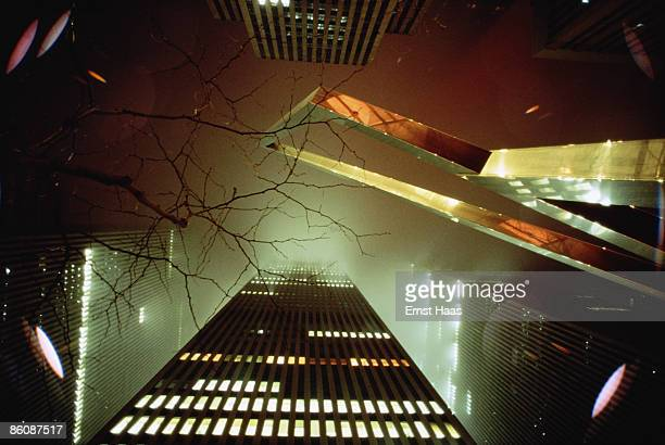 Skyscrapers rise into the fog above New York City circa 1980