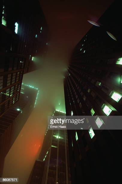 Skyscrapers rise through the fog in New York City 1980