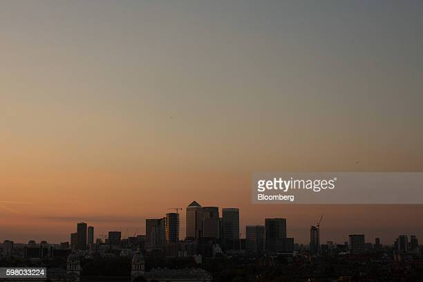 Skyscrapers sit on the skyline at the Canary Wharf financial shopping and business district in London UK on Tuesday Aug 30 2016 Few places in greater...