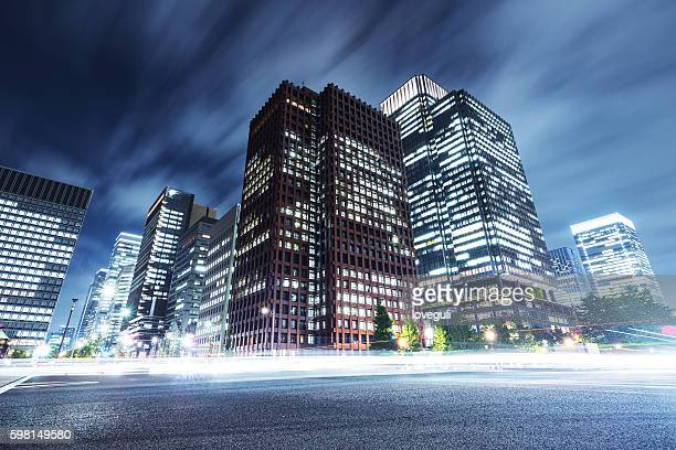 skyscrapers with busy traffic at night
